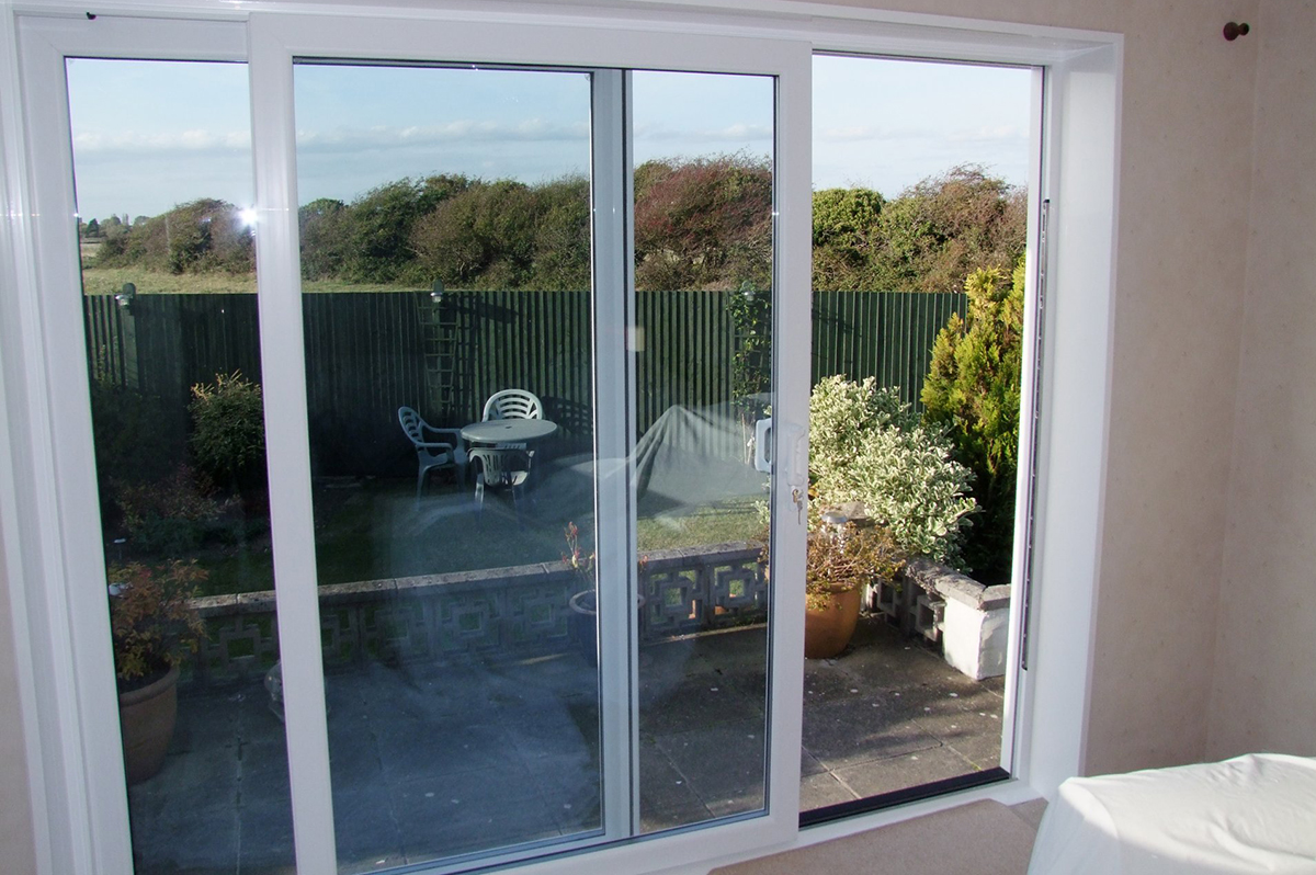 Replacement sliding patio doors replacement sliding for Backyard sliding door